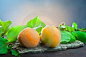 Apricot On Wood And Background Leaf Royalty Free Stock Photo - Image: 20370785