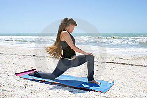 Woman Doing Yoga On Beach Low Lunge Royalty Free Stock Photo - Image: 20373065