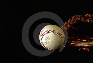 Baseball in the dark Stock Photos