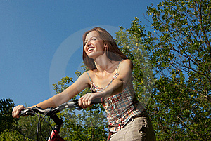 Pretty Young Woman With Bicycle In A Park Smiling Royalty Free Stock Images - Image: 20411559