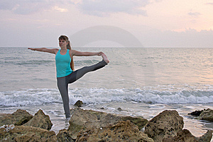 Woman Doing Yoga Exercise At  Beach Royalty Free Stock Photo - Image: 20414575