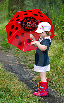 Little Girl With An Umbrella Royalty Free Stock Images - Image: 20414669