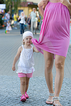 Little Girl Is Holding Mother Dress During Walk Stock Photography - Image: 20416962