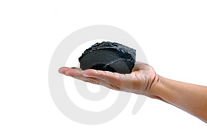 Male Hand Holding A Little Lump Of Coal Royalty Free Stock Image - Image: 20419596