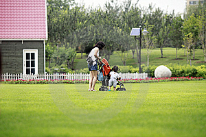 Mother And Daughter On The Lawn. Stock Image - Image: 20426611