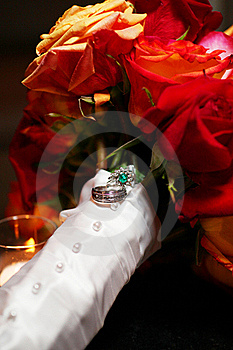 Wedding Rings On Rose Bouquet Stock Photos - Image: 20437173