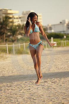 Happy Woman Running On The Beach Royalty Free Stock Images - Image: 20438449