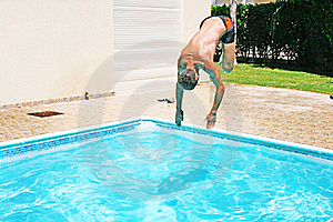 Man Jumping To Swimming Pool Royalty Free Stock Photography - Image: 20440617