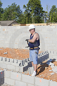 Mason With Concrete Block Royalty Free Stock Photo - Image: 20448435