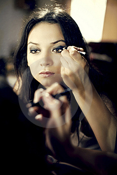 Beautiful Young Woman Looking In Mirror Paint Eyes Stock Image - Image: 20470991