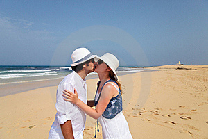 Kissing Honeymooners On A Beach Stock Images - Image: 20472004