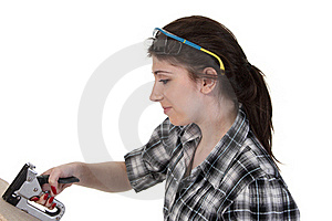 Girl With A Staple Gun Stock Photography - Image: 20472032