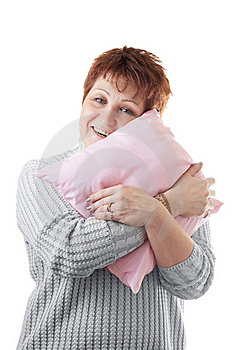 Happy Woman Hugs Pink Pillow Royalty Free Stock Photography - Image: 20476037