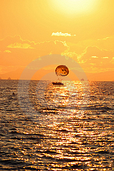 Boat With A Parachute At Sunset Stock Image - Image: 20479851