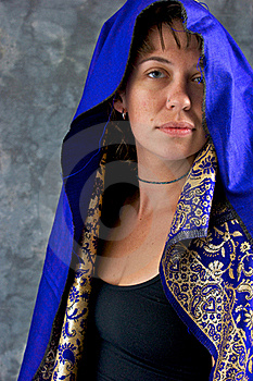 Young Woman In Blue And Gold Cape Royalty Free Stock Photo - Image: 20493145