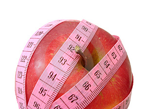 Apple with pink tape measure over white background (concept of h Stock Image