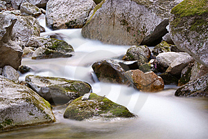 Flowing Stream Between The Rocks Royalty Free Stock Photography - Image: 20501027