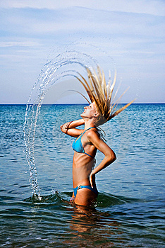 A Girl Splashing The Sea Water With Her Hair Stock Image - Image: 20507781
