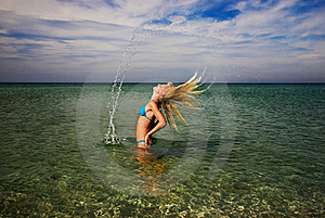 A Girl Splashing The Sea Water With Her Hair Stock Photos - Image: 20507783