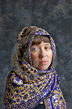 Sad Looking Woman Wrapped In Shawl Stock Image - Image: 20509711