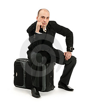 Businessman Sitting On His Luggage Royalty Free Stock Photos - Image: 20521858
