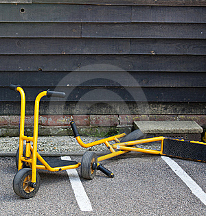 Yellow Scooters In A School Yard Stock Photo - Image: 20527450