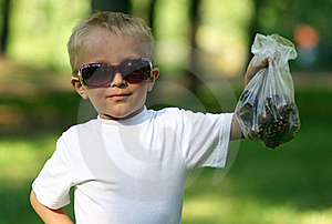 Boy In Dark Glasses With A Package Of Pines Royalty Free Stock Photography - Image: 20528527