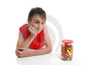 Boy Ponders To Open Jar Confectionery Stock Photo - Image: 20534060