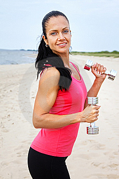 Sportswoman Is Holding Weights Royalty Free Stock Photo - Image: 20540165