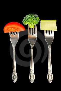 Forks With Vegetables On A Black Background Stock Image - Image: 20543681