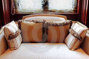 Sofa With Pillows By The Window Royalty Free Stock Images - Image: 20550709