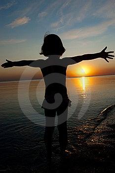 Kid On Sunset Beach Stock Image - Image: 20554941