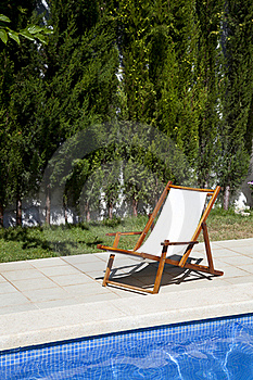 Deckchair In A Swimming Pool Stock Image - Image: 20556631