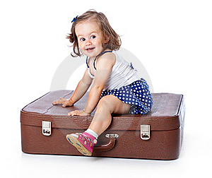 A Little Girl On The Suitcase Stock Images - Image: 20567434