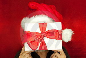Gift In Front Of Face Royalty Free Stock Images - Image: 20568229