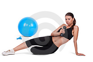Strong Girl Lifting Dumbbells On Fitball Stock Photos - Image: 20568663