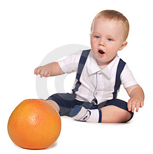 Child Reaches Out To Orange, Focus On Oranges Royalty Free Stock Image - Image: 20571486