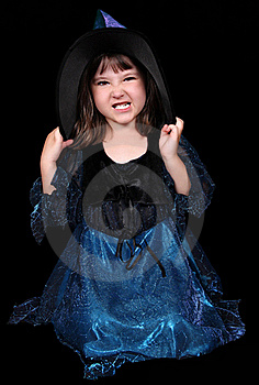 Sweet Little Witch Making A Scary Face Royalty Free Stock Photo - Image: 20572815