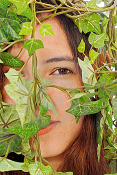 Girl Hiding Behind Ivy Stock Photo - Image: 20581760