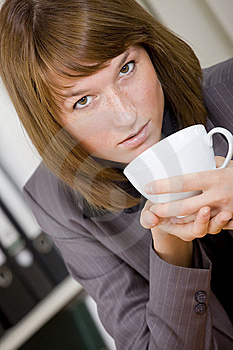 Woman Having Coffee Break At Office Royalty Free Stock Image - Image: 20588586