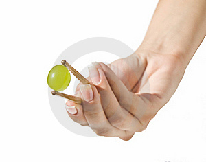 Green Grape Held With Sticks (focus On Grape) Royalty Free Stock Images - Image: 20613489