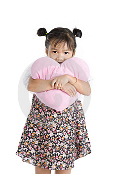 Girl With Heart Shaped Pillow Stock Photo - Image: 20634920