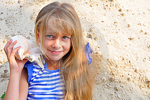 Long-haired Girl Listening To A Seashell Stock Image - Image: 20636831