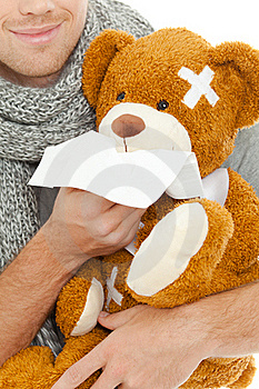 Man With Tissue And Bear Royalty Free Stock Photography - Image: 20637517