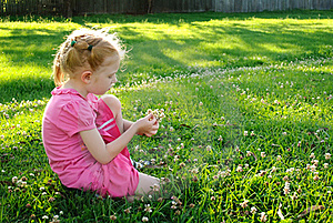Young Girl In Pink Picking Up Flowers In A Field Stock Images - Image: 20637534