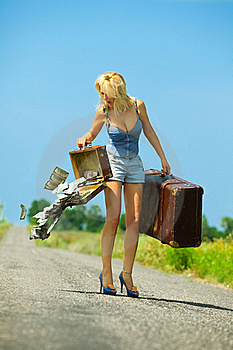Woman Holding  Opening Suitcases With Cash Royalty Free Stock Photography - Image: 20639717