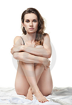 Sexy Woman Sitting On The White Bed Royalty Free Stock Images - Image: 20640999