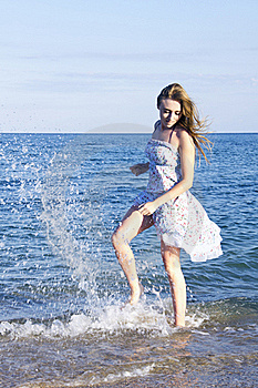 Young Lady Jumping With Splash In The Sea Royalty Free Stock Images - Image: 20644039