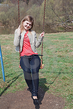 Young Girl In The Park Sitting On The Swing Royalty Free Stock Photos - Image: 20653878