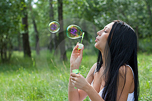 Girl Inflates The Bubbles Stock Photography - Image: 20656642
